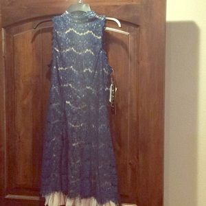NWT- never worn ladies blue lace and nude dress.